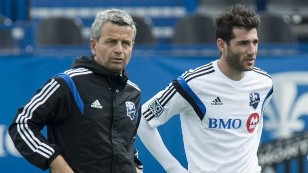 Montreal Impact's newly acquired designated player Ignacio Piatti, right, listens to coach Frank Klopas during a practice on Thursday.
