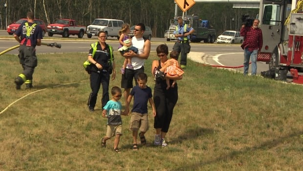 A woman and her children out for a bike ride Saturday walked away safe and sound after a semi flipped nearby, splashing water on them. They were checked out by paramedics on scene.