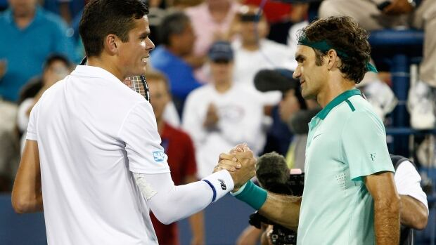 Milos Raonic congratulates Roger Federer after their semifinal at the Western & Southern Open tennis tournament Saturday. Federer won 6-2, 6-3.