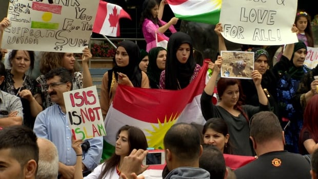 About 200 members of Calgary's Kurdish community rallied at City Hall Sunday to condemn brutality by ISIS fighters in Iraq and call for greater international support for Kurdish forces.