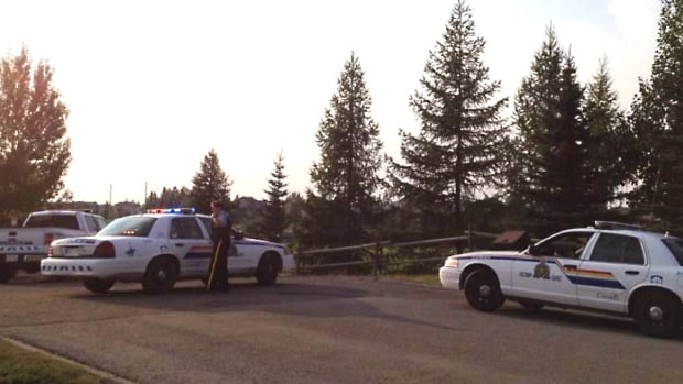 Cochrane RCMP set up around Mitford Park Sunday night to hunt for a man witnesses say was carrying a rifle and crossbow.