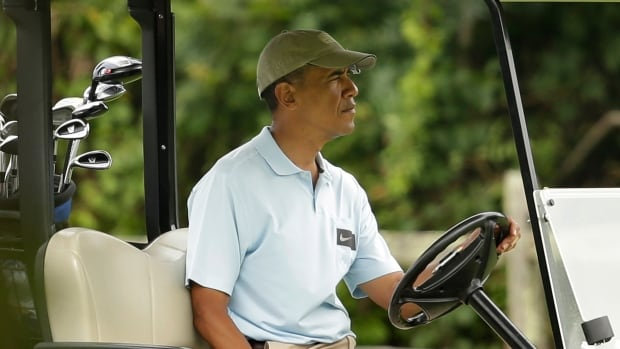 President Barack Obama sits in a golf cart at Farm Neck Golf Club, in Oak Bluffs, Mass., on the island of Martha's Vineyard on Aug. 17, 2014. In a rare move for him, the president planned a break in the middle of his Martha's Vineyard vacation to return to Washington Sunday night for unspecified meetings with Vice President Joe Biden and other advisers.
