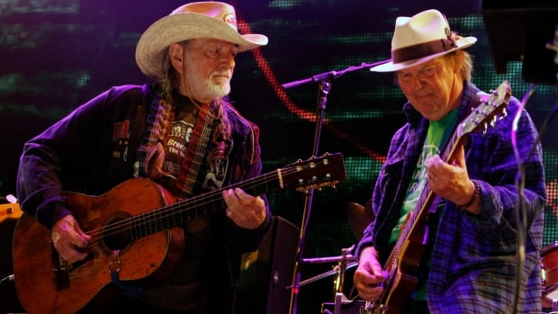 Neil Young, right, and Willie Nelson perform during the Farm Aid 2012 concert at Hersheypark Stadium in Pennsylvania in this Sept. 22, 2012, file photo. Opponents of a proposed pipeline that would carry oil from Canada south to the Gulf Coast now say the pair will headline a concert on Sept. 27 on a farm near Neligh in northeast Nebraska.