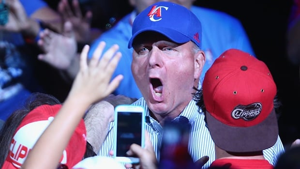Steve Ballmer whoops it up as he is introduced as new team owner at the Clippers Fan Festival at Staples Center on Monday.