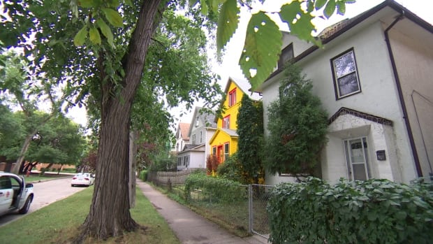 A Winnipeg family has been forced out of this Point Douglas home after an asbestos remediation job was botched inside.