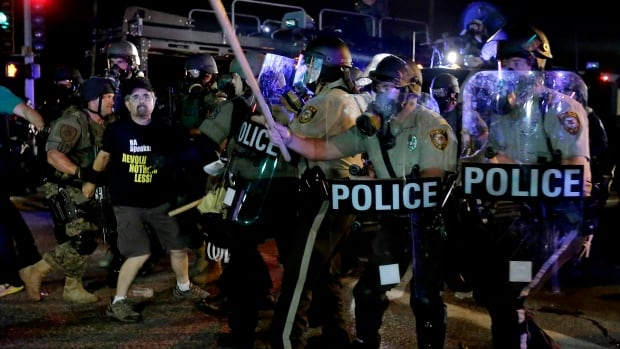 Tensions between police, who began firing tear gas Monday night, and demonstrators has increased in Ferguson.