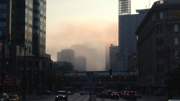 Early morning Winnipeg commuters drove through fog downtown Tuesday morning.