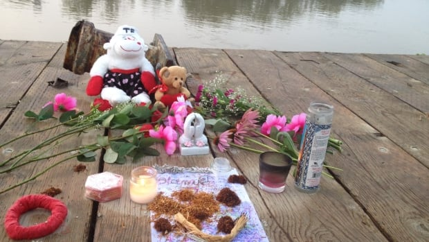 Flowers and tobacco form a makeshift memorial for Tina Fontaine at the Alexander Docks in Winnipeg on Tuesday.