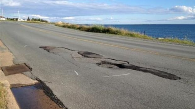 An Eastern Passage man says he'll fill potholes like these himself if the city doesn't soon.