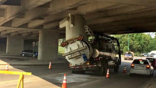 A vacuum truck lodged under the Circle Drive overpass at Ruth Street.