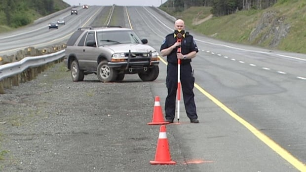 A Royal Newfoundland Constabulary officer collected measurements on the Outer Ring Road after a crash that left a highway worker dead in July 2011.