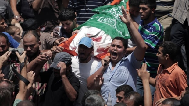 Mourners chant at the funeral of Palestinian Widad Mustafa Deif, 27, who was killed with her eight-month-old son Ali Mohammed Deif in Israeli strikes in Gaza City late Tuesday. She was the wife of Mohammed Deif, leader of the Hamas military wing.