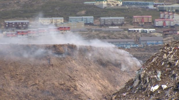 Smoke rises from the Iqaluit dump on August 7, 2014. The fire has been burning since May 20, 2014, but the Fire Chief says it could have been smouldering deep within the pile for months or even years.
