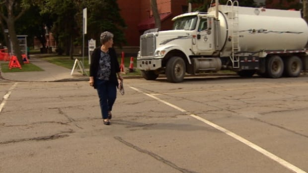 Mary Tychkowsky uses the same crosswalk at 95th Avenue and 92nd Street where an 84-year-old woman was struck in April. Tychkowsky has been fighting to get the crosswalk upgraded for the last two years.