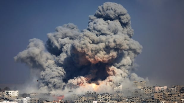 In this Tuesday, July 29, 2014 file photo, smoke and fire rise from the explosion of an Israeli strike in Gaza City. Hamas admitted in August that it had kidnapped and killed 3 Israeli teens.