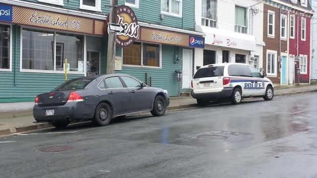 Police are at the scene of an assault in front of Ches's Fish & Chips.