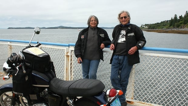 North Bay's Max Burns and his wife Jackie Quinton (left) take a break from riding while island hopping in southwestern New Brunswick. Burns, who has been riding since he was 14, contends it's too easy for people to get a motorcycle licence.
