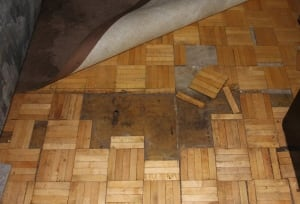 Floor damage in tenant Paul Chahor's apartment at 154 Erb St. E. in Waterloo