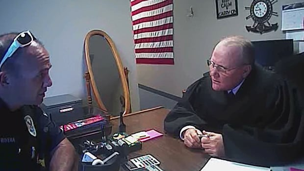 Markel Chiles sat as a justice of the peace in Mesa, Ariz. until 2013, when he was caught shoplifting. This is a still from a U.S. police video showing their confrontation with Chiles when they went to question him about the incident.