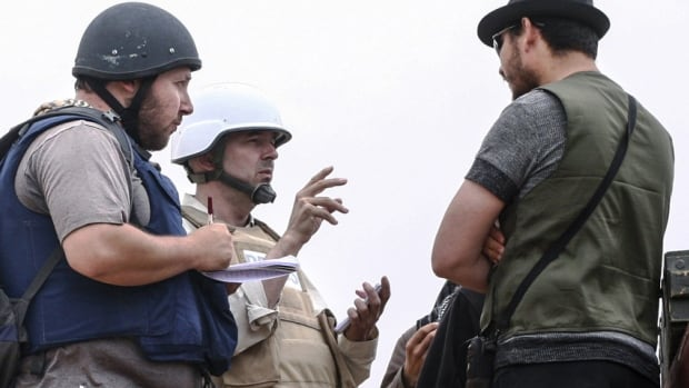 Photographer Yves Choquette says he did not compromise the safety of American journalist Steven Sotloff, far left, who was kidnapped in Syria last year and also appeared in a recent jihadist video in which fellow U.S. journalist James Foley was executed.