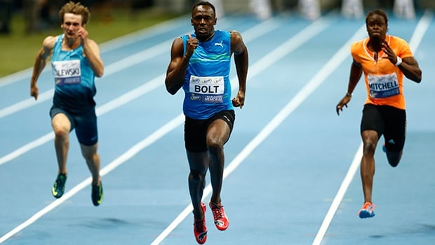 Usain Bolt, middle, sprints to victory over Karol Zalewski, left, and Sheldon Mitchell at National Stadium in Warsaw on Saturday.