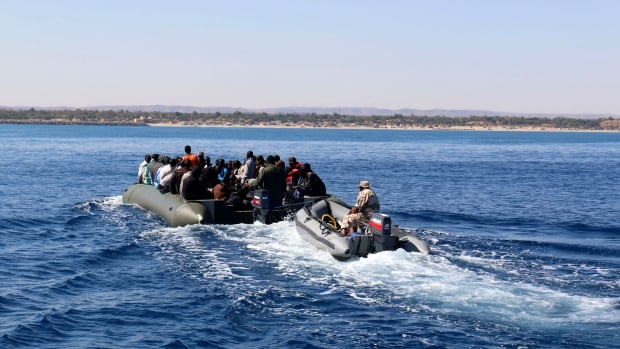 Libya is a common departure point for African migrants trying to reach Italy. Here, the local coast guard in Garbouli escorts a group of migrants  who had tried to make the crossing in June. Last Friday, a similar attempted crossing ended in tragedy when the migrants' ship sank, killing at least 250 people on board.