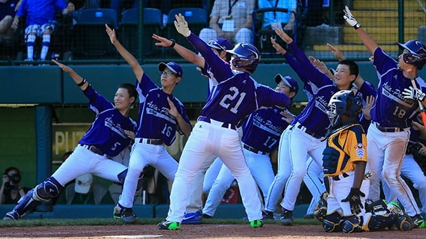 Hae Chan Choi (21) and Asia-Pacific salute his home run in Sunday's 8-4 win over Great Lakes Chicago at Williamsport, Penn.