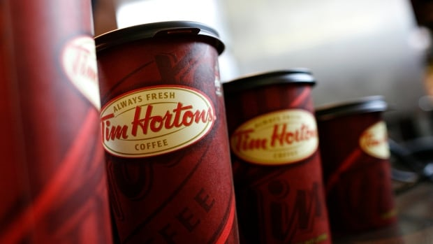 A row of Tim Hortons coffee cups are lined up for customers at Penn Station in New York, July 13, 2009.