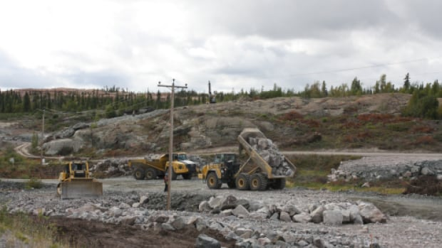 Crews at work on the Giant Mine bypass just outside of Yellowknife. Transportation officials hope to complete the final kilometre of the highway before winter, but admit it may be too late to add the chip seal this year.