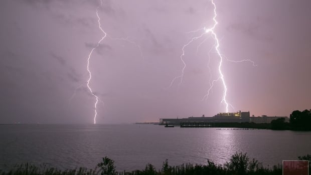 Thunder Bay photographer Dave Zahodnik was taking pictures, like this one, of Monday's thunder and lightning storm from Marina Park when he says a nearby lightning strike knocked him to the ground.