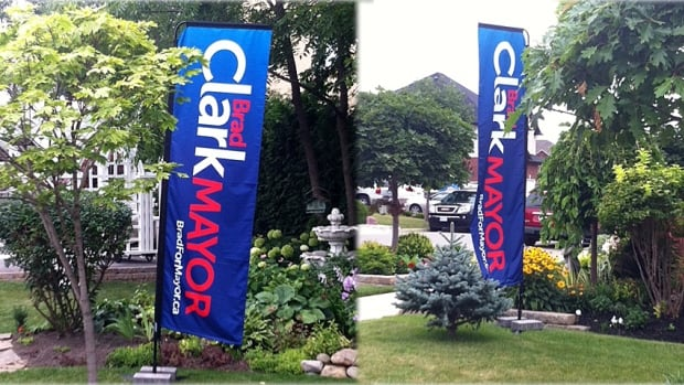 Brian McHattie's campaign has filed a formal complaint with the city after the campaign for fellow mayoral candidate Brad Clark placed these signs on a lawn near the Winona Peach Festival this weekend. The city's sign bylaw dictates that election signs not be posted until 28 days before voting day. Clark's campaign says the home was being used as a temporary office.
