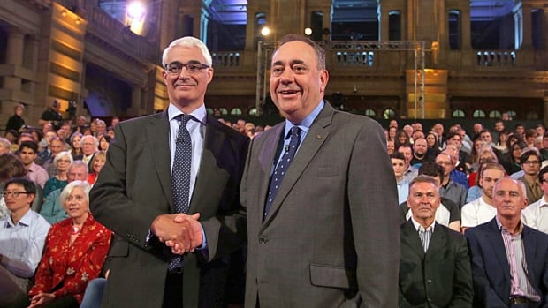 Better Together leader Alistair Darling, left, and Scotland's First Minister, Alex Salmond, shake hands prior to the second and final television debate over Scottish independence on Monday. The pair argued and shouted over each other on a number of questions, but the heart of the 90-minute exchange centred on what currency an independent Scotland would use.