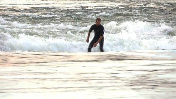 Some surfers say the poor water quality in the St. Lawrence River has made them sick.