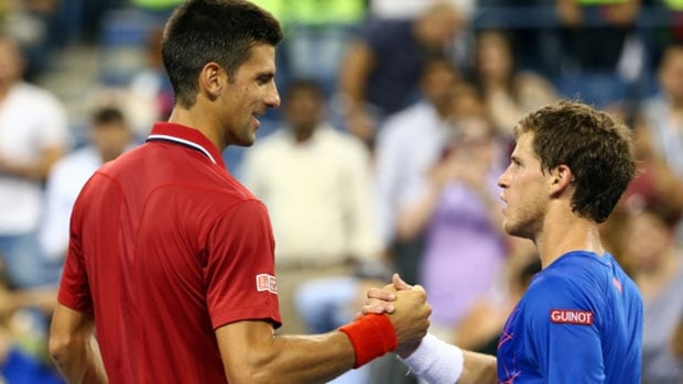 Novak Djokovic, left, greets Diego Schwartzman of Argentina after the Serb advanced at the U.S. Open Monday night in New York.