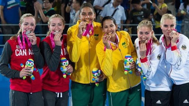 Canada's McNamara twins, Megan and Nicole, won a silver medal Tuesday in beach volleyball at the Youth Olympic Games in Nanjing, China. Brazil's Ana Patricia Silva and Eduarda Lisboa, middle, won gold and Germany's Lisa Arnholdt and Sarah Schneider, right, bronze.