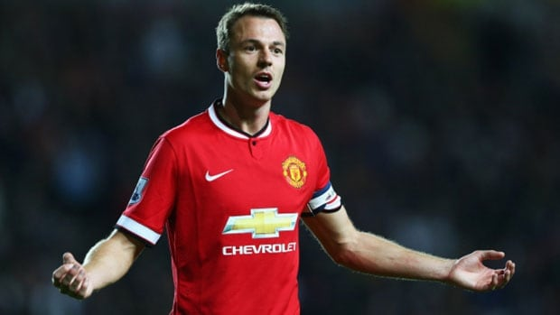 Manchester United's Jonny Evans shows his frustration during a League Cup match against MK Dons.