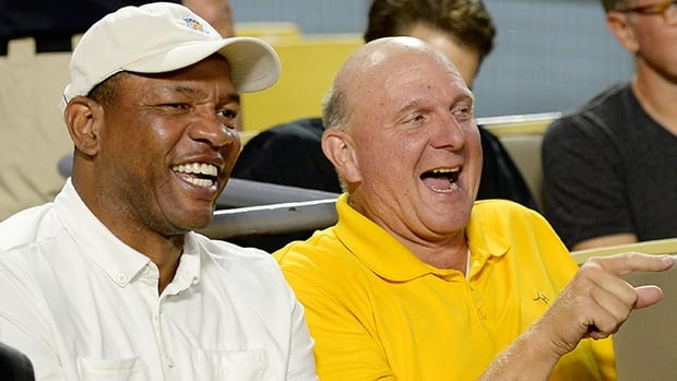 Doc Rivers, left, was rewarded Wednesday with a five-year contract extension from new Clippers owner Steven Ballmer, right.