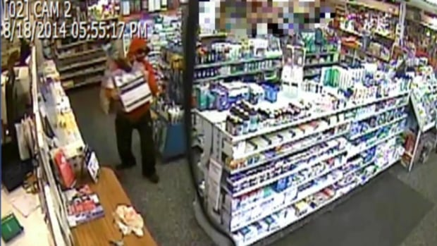 Surveillance video footage shows a man who walked into the drugstore, while wielding what looks like a knife, then demanded narcotics. He then fled the scene on foot.