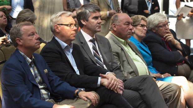 Northwest Territories Premier Bob McLeod, third from right, says he supports n inquiry into missing and murdered aboriginal women, but work can begin now to tackle known problems.