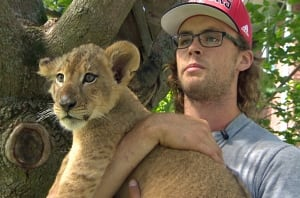 Riley Tripp and Congo the lion cub