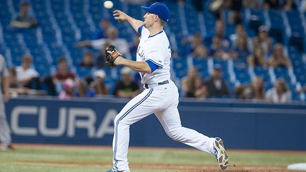 Toronto Blue Jays infielder Steve Tolleson pitches against Boston Red Sox during 11th inning Tuesday night at Rogers Centre.