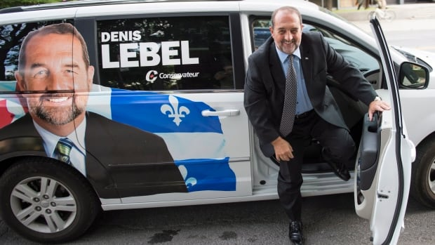 Tory MP Denis Lebel arrives in his marked van to address supporters Monday, August 25, 2014 in Montreal. A pre-electoral push by the federal Conservatives is underway in Quebec to charm Quebecers even though the next election could be more than a year away. Lebel is trying to woo a province where the party holds just five seats and polls have often suggested it sits fourth in popular support.