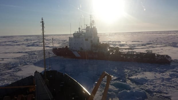 The CCGS Terry Fox and the CCGS Louis S. St-Laurent manoeuvre through sea ice en route to the North Pole. The ships arrived on the evening of August 27.
