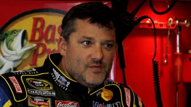 Tony Stewart, pictured here, will return to Sprint Cup competition Sunday night at Atlanta Motor Speedway, ending a three-race hiatus taken after he struck and killed fellow driver Kevin Ward Jr. during a dirt-track race.