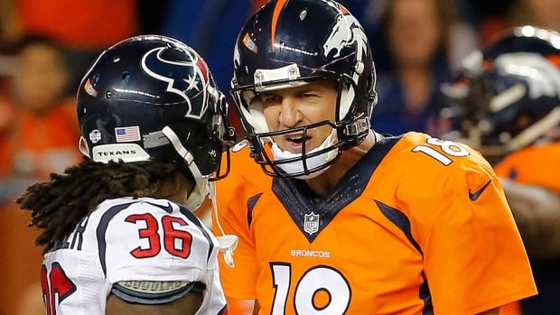 Broncos quarterback Peyton Manning, right, talks to Texans strong safety D.J. Swearinger (36) after a Broncos touchdown during the first half of an NFL pre-season game on Aug. 23. Manning was whistled for taunting and reportedly fined more than $8,000 US by the NFL on Thursday.