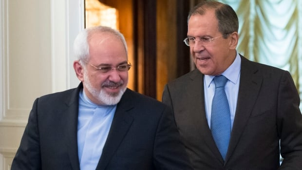 Iranian Foreign Minister Mohammad Javad Zarif, left, and Russian Foreign Minister Sergey Lavrov enter the hall for their talks in Moscow on Friday.