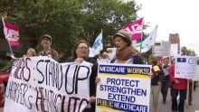 Protesters march in Charlottetown in support of medicare