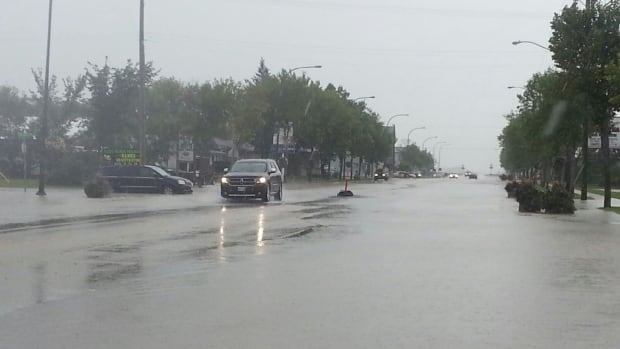 Niverville streets filled with water as a thunderstorm sweeps through the area Friday afternoon.