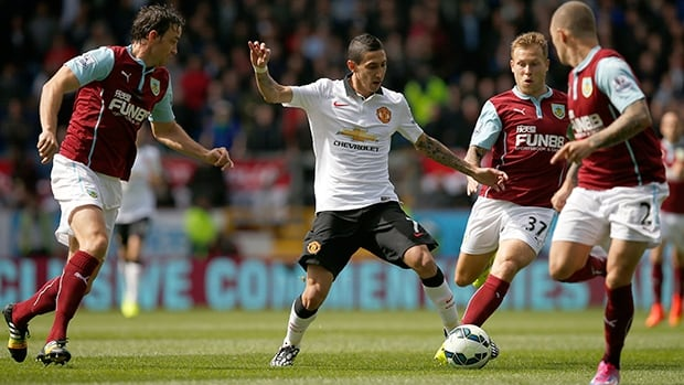 Manchester United newcomer Angel Di Maria, middle, is surrounded in a 0-0 draw with Burnley at Turf Moor on Saturday.