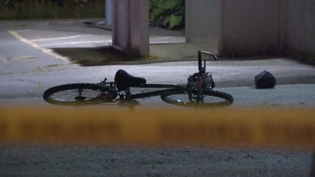 A forensic team gathered a bicycle and a duffel bag that were found at the scene.